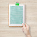 Hand holding green clipboard Royalty Free Stock Photo
