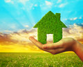Hand holding green Eco house icon Royalty Free Stock Photo