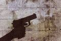 Hand holding gun silhouette Royalty Free Stock Photo