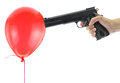 Hand holding at gunpoint a red balloon isolated on white Royalty Free Stock Photography
