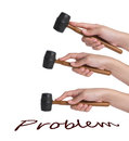 Hand holding hammer beat problems. Royalty Free Stock Photo