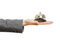 Hand holding hotel bell on the palm Royalty Free Stock Photo
