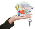 Hand holding house keys euro money female little and bills Royalty Free Stock Image