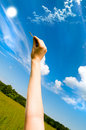 Hand holding keys, blue skies in the background Royalty Free Stock Photo