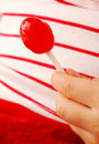 Hand Holding Lollipop Royalty Free Stock Image