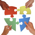Hand holding love shape puzzle trying to put a together to become Royalty Free Stock Image