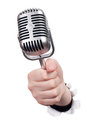 Hand holding microphone Stock Photography