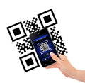 Hand holding mobile phone with qr code screen isolated over whit white background Royalty Free Stock Images