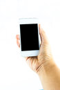 Hand holding mobile smart phone with blank screen on white background Royalty Free Stock Photos