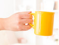Hand holding a mug closeup of woman s of drink Stock Photo