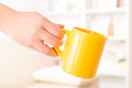Hand holding a mug closeup of woman s of drink Stock Photography