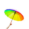 Hand Holding multicolored umbrella isolated Royalty Free Stock Images