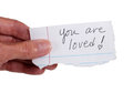 Hand holding note that reads 'You Are Loved' Royalty Free Stock Photos