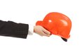 Hand holding out the construction orange helmet on a white background Royalty Free Stock Images