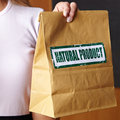 Hand holding paper bag Royalty Free Stock Images
