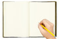 Hand holding pencil on blank note book couple page of notebook Royalty Free Stock Photos