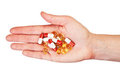 Hand holding pills Royalty Free Stock Photos