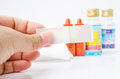 Hand holding plaster with antiseptic and alcohol in first aid kit Royalty Free Stock Photo