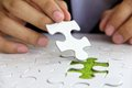 Hand holding puzzle piece green space concept Royalty Free Stock Images