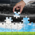 Hand holding puzzles to assembly for changing view Royalty Free Stock Photo