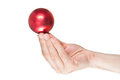 Hand holding a red christmas ball Royalty Free Stock Photography
