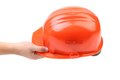 Hand holding red helmet over white. Royalty Free Stock Photo