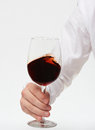 Hand holding red wine glass Royalty Free Stock Photo