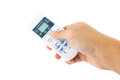 Hand is holding a remote control of air conditioner Royalty Free Stock Photo