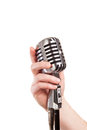 Hand holding a retro microphone isolated on white Royalty Free Stock Photos