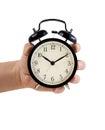 Hand Holding Retro Style Alarm...