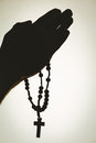 Hand holding rosary beads Royalty Free Stock Photo
