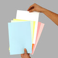 Hand holding sheets of paper Stock Image