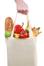 Hand holding a shopping bag filled with groceries Royalty Free Stock Photo