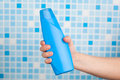 Hand holding shower gel Royalty Free Stock Photo
