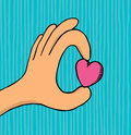 Hand holding small heart love cartoon illustration of a showing its Royalty Free Stock Photography