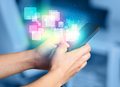 Hand holding smart phone with abstract glowing squares Royalty Free Stock Photo