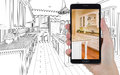 Hand Holding Smart Phone Displaying Photo of Kitchen Drawing Beh Royalty Free Stock Photo