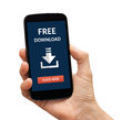 Hand holding smart phone with free download concept on screen