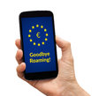 Hand holding smart phone with free roaming concept on screen Royalty Free Stock Photo