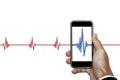 Hand holding smart phone with heart rhythm ekg, isolated on white background Royalty Free Stock Photo