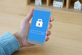 Hand holding smart phone with password login on screen backgroun Royalty Free Stock Photo