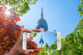Hand holding smart phone take a photo at Seoul Tower. Royalty Free Stock Photo