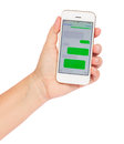 Hand holding smartphone with sms clouds empty isolated in white background Royalty Free Stock Images