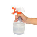 Hand holding a spray bottle with laundry detergent isolated over whiter background Stock Photo