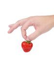 Hand holding a strawberry white background Royalty Free Stock Image