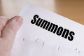 Hand holding summons letter Royalty Free Stock Photo