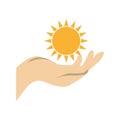Hand holding a sun shape