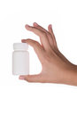 Hand holding supplements or vitamin bottle on white isolated background Stock Photo