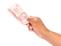Hand holding thai money on white background Royalty Free Stock Photography