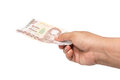 Hand holding thai money on white background Stock Images
